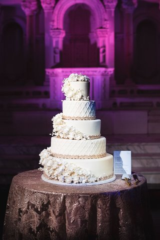 wedding-cake-five-layer-fondant-confection-sugar-flowers-wrapping-around-each-layer-moroccan-lace