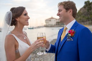 couple-toast-champagne-at-beach-wedding