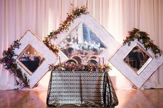 sweetheart-table-with-metallic-linens-large-framed-mirror-as-backdrop