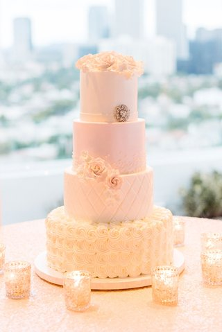 white-wedding-cake-with-blush-silver-and-gold-details-flowers-quilting-candles-roses-simple-topper