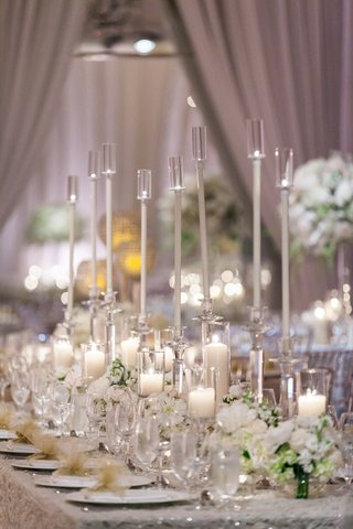 long-arrangement-glass-candles-floral-runner-shimmering-linen-greenery-classic-wedding-reception