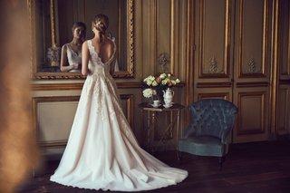 mckinley-eddy-k-bhldn-wedding-dress-with-lace-details-v-back-in-light-blush-shade
