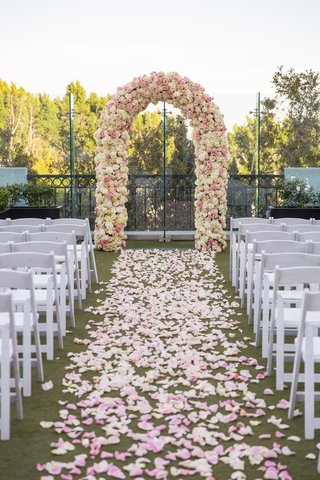 rooftop-wedding-ceremony-petal-lined-aisle-arch-of-ivory-and-pink-roses