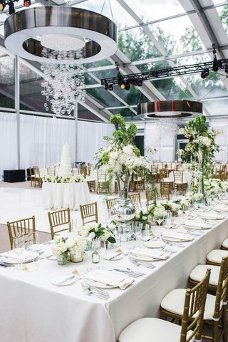 wedding-reception-in-glass-tent-with-circular-chandeliers-and-hanging-glass-spheres