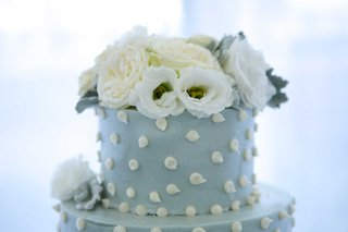 top-tier-couples-blue-wedding-cake-white-polka-dots-flowers-on-top