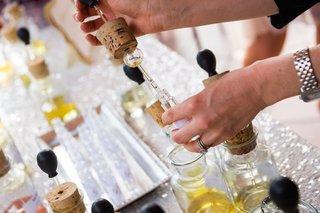 attendant-helps-wedding-shower-guest-make-perfume