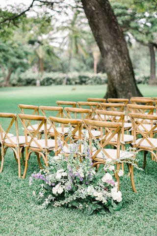hawaii-wedding-ceremony-outdoor-lawn-plantation-wood-chairs-greenery-purple-white-flowers-entrance