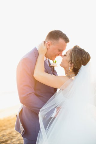 wedding-portrait-bride-veil-blowing-in-wind-close-almost-kiss-sunset-on-beach-california