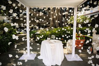 orchid-flowers-on-strings-surrounding-altar-chuppah-open-sided-ivory-wedding-ideas