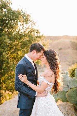 bride-in-off-shoulder-galia-lahav-wedding-dress-hair-worn-down-prickly-pear-cactus-mountain-golden