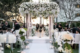 wedding-ceremony-romantic-white-aisle-runner-candles-white-flowers-birch-in-the-round-seating