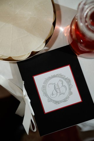 wedding-ceremony-program-elizabeth-grace-black-stationery-white-ribbon-red-border-silver-monogram