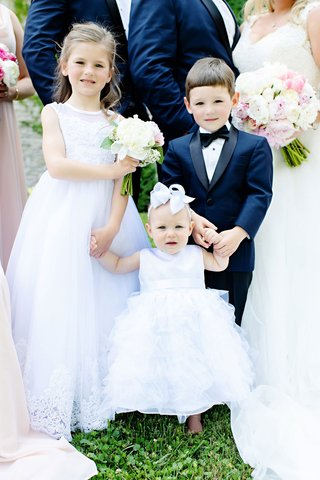 wedding-party-two-flower-girls-holding-hands-baby-toddler-child-little-ring-bearer-navy-blue-tuxedo
