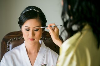 dolled-up-by-lulu-eyemakeup-applied-to-asian-american-bride-in-white-robe