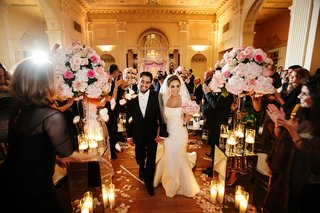 bride-in-fit-n-flare-gown-and-groom-walk-up-ballroom-aisle