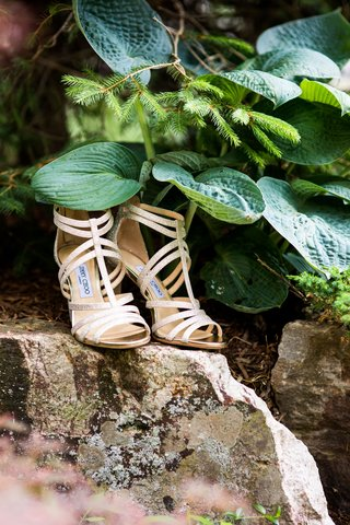 jimmy-choo-strappy-sandals-peep-toe-ankle-straps-on-rock-in-upstate-new-york-greenery-rustic