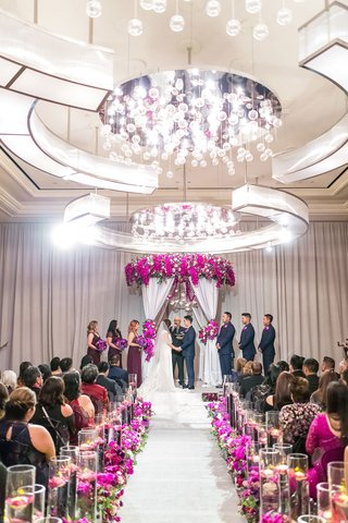 elegant-las-vegas-wedding-ceremony-fuchsia-flowers-mirrored-details-floating-candles
