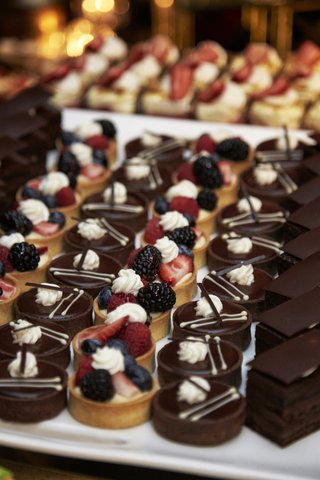 mini-fruit-tarts-and-chocolate-treats-at-wedding-dessert-bar