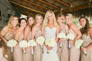 bride-white-trumpet-gown-her-bridesmaids-in-champagne-colored-dresses-bead-embellishments-straps