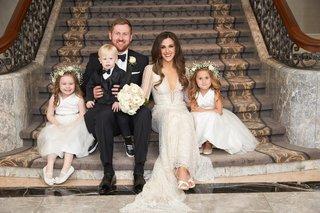 bride-in-inbal-dror-wedding-dress-with-groom-in-tuxedo-and-little-ring-bearer-flower-girls-flowers