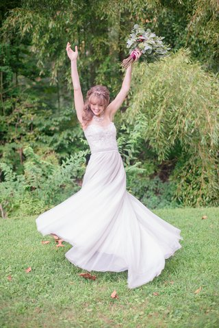 bride-twirling-in-a-line-gown-beaded-bodice-sweetheart-neckline-rustic-bouquet