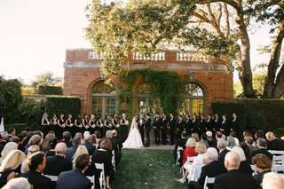 wedding-at-filoli-ceremony-in-front-of-brick-building-covered-in-ivy