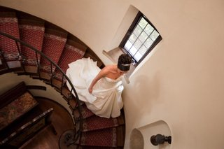 bride-in-a-monique-lhuillier-gown-walks-down-the-stairs