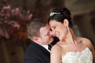 bride-with-an-updo-and-tiara-and-groom-in-a-black-tuxedo