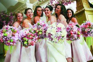 bride-with-a-bouquet-of-white-pink-and-lavender-flowers-and-bridesmaids-holding-pink-and-lavender