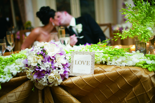 wedding-sweetheart-table-with-golden-tablecloths-and-white-orchids
