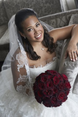 bride-in-vera-wang-with-round-bouquet-of-dark-red-roses