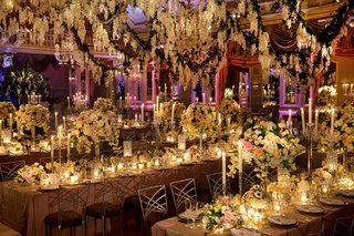 long-banquet-tables-topped-with-tall-floral-arrangements