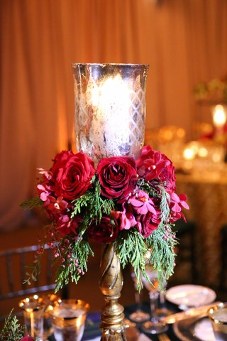 gold-candlestick-with-votive-red-roses-greenery-on-reception-table
