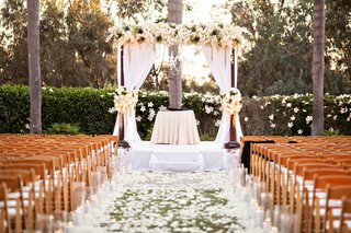white-decor-for-outdoor-ceremony-california-wedding-flower-petals-on-grass-lawn-aisle
