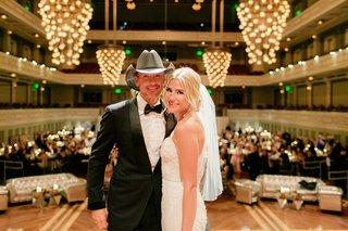 bride-in-inbal-dror-mermaid-wedding-dress-with-tim-mcgraw-at-wedding-reception