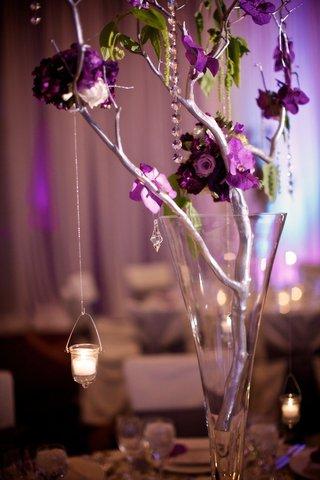 fluted-vase-filled-with-floral-embellished-branch