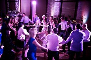 wedding-guests-dancing-in-purple-lighting