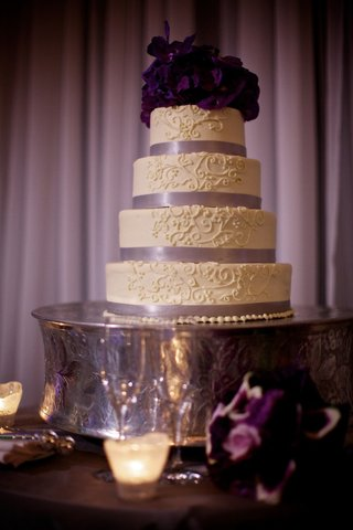 four-layer-cake-with-ribbons-and-white-design