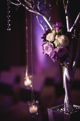 silver-tree-decorated-with-purple-flowers-and-candles