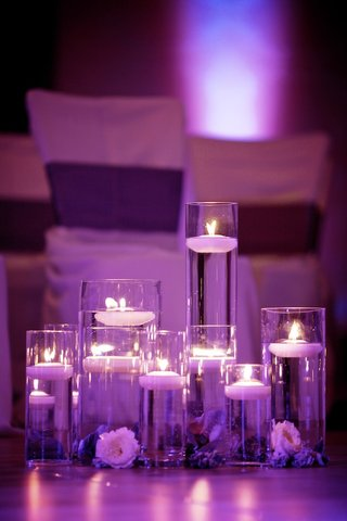 purple-lighting-on-candle-filled-cylindrical-vases