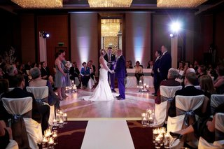 indoor-wedding-in-center-of-room-with-candles