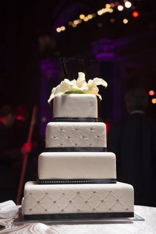 white-wedding-cake-with-quilted-layers-dotted-with-rhinestones-topped-with-white-calla-lilies