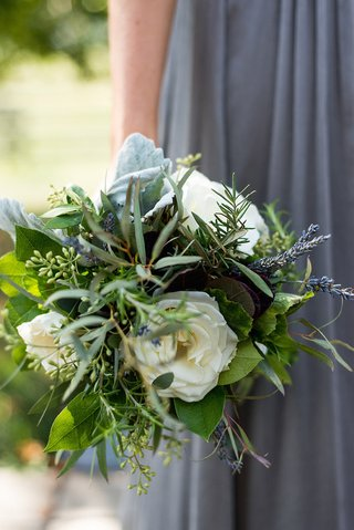 bridesmaid-in-grey-dress-holds-green-and-white-bouquet-with-dusty-miller-lambs-ear-lavender
