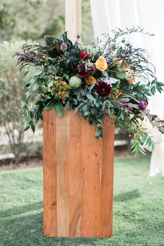 colorful-floral-arrangement-altar-ceremony-southern-california-boho-winter-wedding-styled-shoot