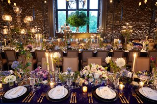 wedding-reception-long-table-navy-blue-gloss-table-english-country-chairs-flowers-white-purple-blue