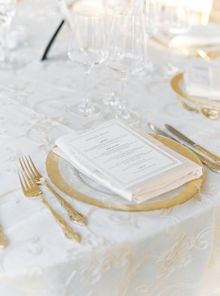 wedding-reception-embroidered-ivory-linen-gold-rim-charger-plate-gold-flatware-dinner-menu-napkin