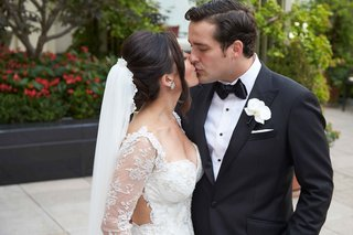 bride-in-galia-lahav-dress-with-removable-lace-long-sleeves-veil-groom-in-tuxedo-and-white-flower
