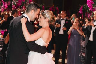 bride-and-groom-first-dance-on-dance-floor-with-sparkling-bridal-headpiece