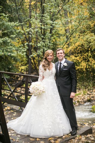 bride-in-lace-isabelle-armstrong-a-line-gown-bride-and-groom-in-forest