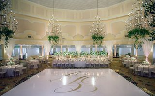 white-dance-floor-gold-monogram-crystal-chandeliers-with-greenery